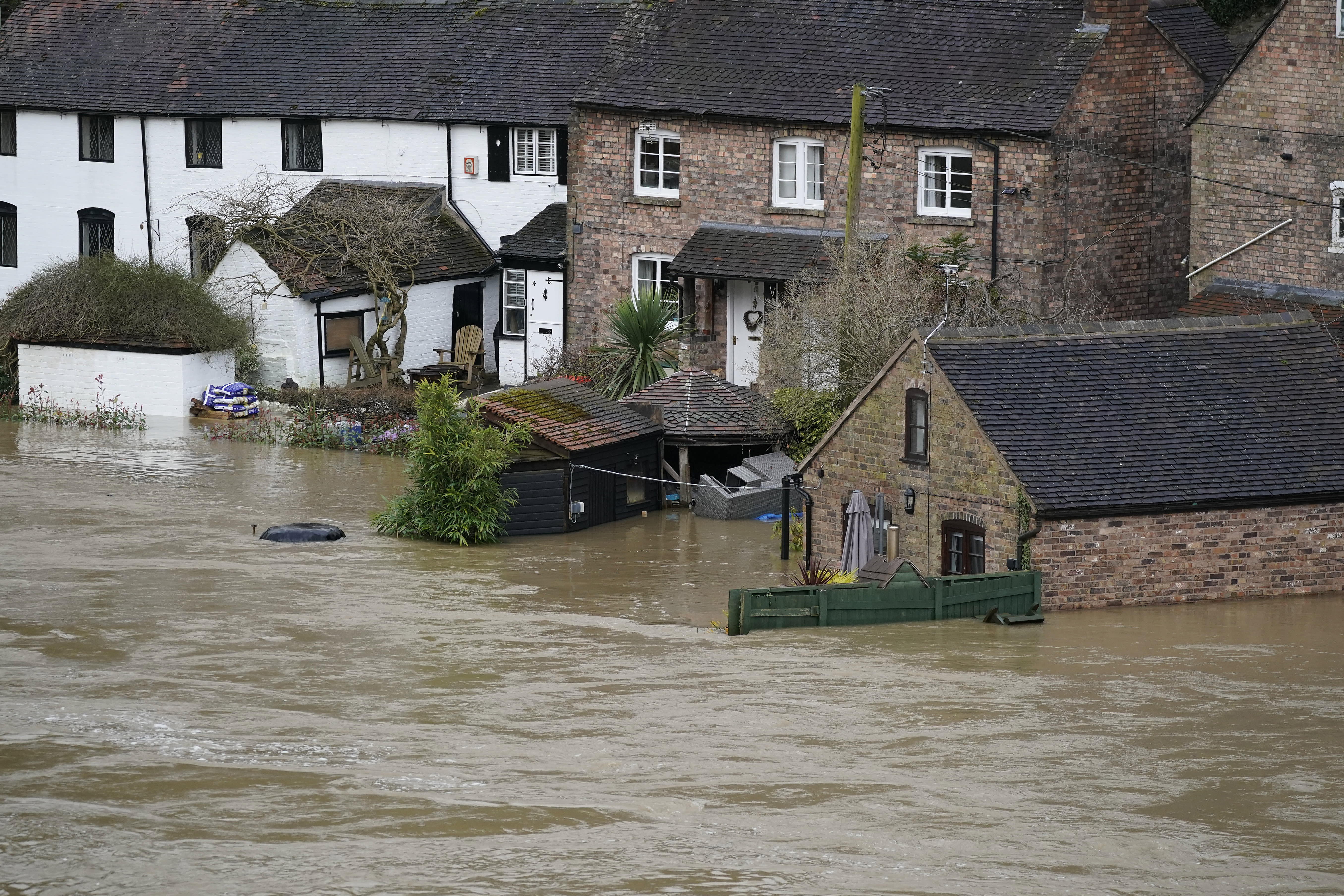 IRONBRIDGE, - FEBRUARY 18: Homes are flooded on the banks of the River Seven following Storm Dennis on February 18, 2020 in Ironbridge, England. Storm Dennis is the second named storm to bring extreme weather in a week and follows in the aftermath of Storm Ciara. Although water is residing in many places flood warnings are still in place. (Photo by Christopher Furlong/Getty Images)