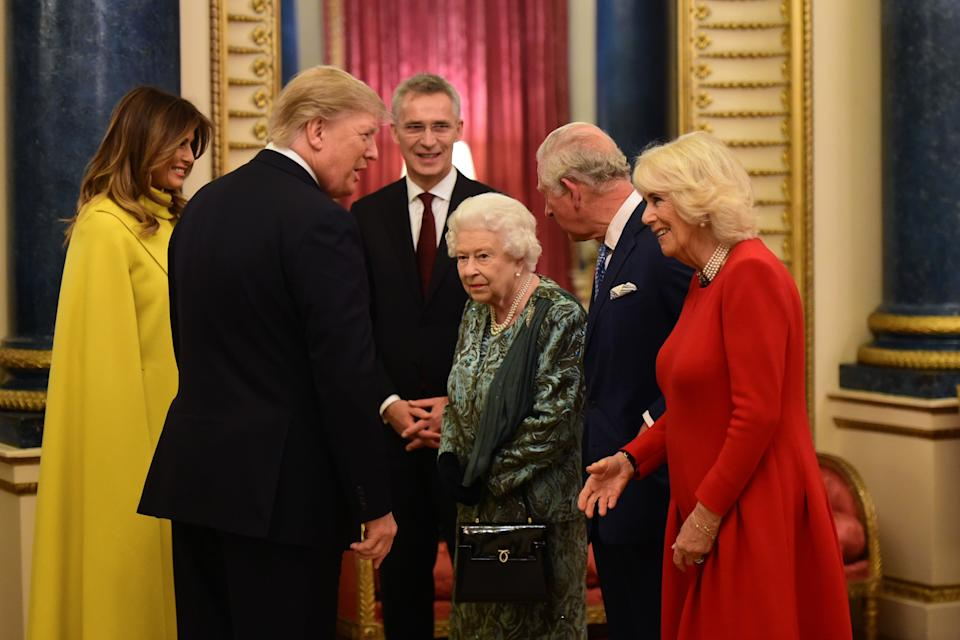 Britain's Queen Elizabeth II (3rd R) speaks with NATO Secretary General Jens Stoltenberg (3rd L), US First Lady Melania Trump (L) and US President Donald Trump (2nd L), Britain's Camilla, Duchess of Cornwall (R) and Britain's Prince Charles, Prince of Wales (2nd R) in Buckingham Palace in central London on December 3, 2019, during a reception hosted by Britain's Queen Elizabeth II ahead of the NATO alliance summit. - NATO leaders gather Tuesday for a summit to mark the alliance's 70th anniversary but with leaders feuding and name-calling over money and strategy, the mood is far from festive. (Photo by Geoff PUGH / POOL / AFP) (Photo by GEOFF PUGH/POOL/AFP via Getty Images)