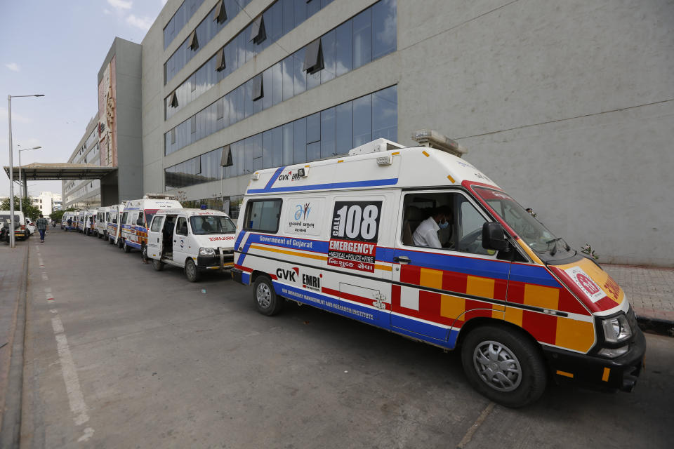 Ambulances carrying COVID-19 patients queue up waiting for their turn to be attended at a dedicated COVID-19 government hospital in Ahmedabad, India on April 17, 2021. (Ajit Solanki/AP)