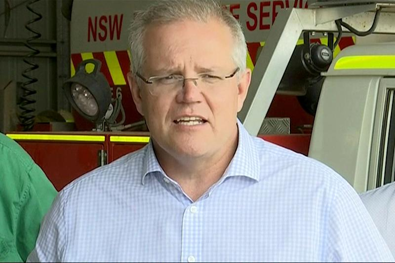 In this image made from video, Australia's Prime Minister Scott Morrison speaks to firefighters in Mudgee, New South Wales Monday, Dec. 23, 2019. Morrison on Monday praised emergency service workers for their efforts to combat fires which raged throughout New South Wales. (Australian Pool via AP) (Photo: ASSOCIATED PRESS)