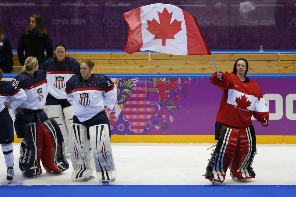 Feb 20, 2014; Sochi, RUSSIA; Canada goalkeeper Shannon Szabados (1) celebrates their 3-2 overtime win over USA in the women's ice hockey gold medal game during the Sochi 2014 Olympic Winter Games at Bolshoy Ice Dome. (Winslow Townson-USA TODAY Sports)