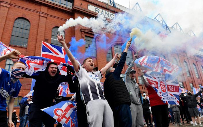 Rangers fans set off smoke bombs as they gather outside the Ibrox Stadium - Getty Images Europe