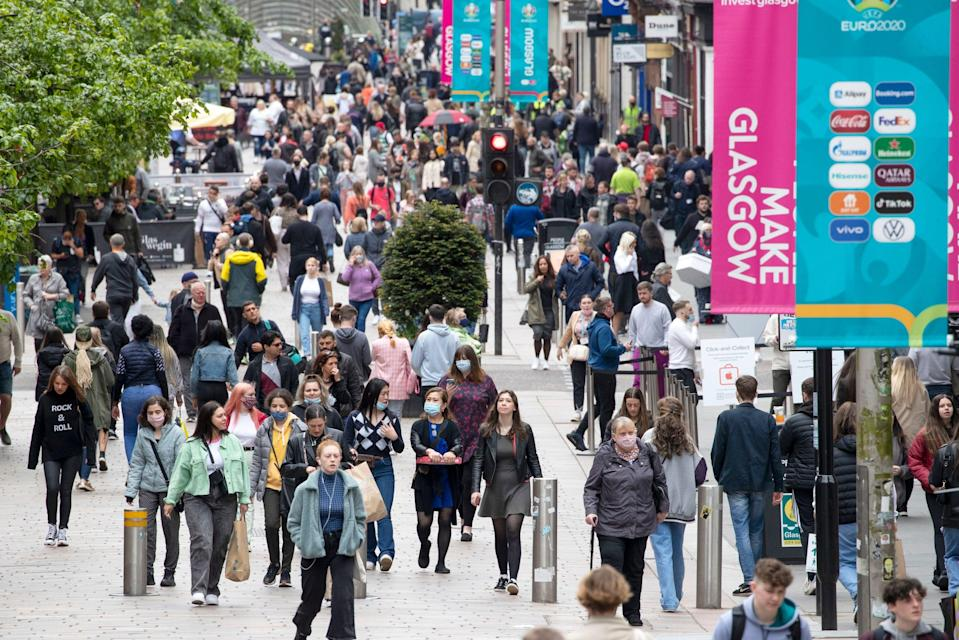 <p>Glaswegians will be able to drink alcohol indoors, meet in private residences, and hug loved ones from the weekend</p> (PA)