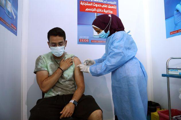 A man receives the COVID-19 vaccine at a mass vaccination venue in Cairo, Egypt. (Photo: Ahmed Gomaa/Xinhua via Getty Images)