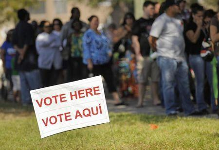 People wait to vote at Good Shepherd Methodist Church during the U.S. presidential election in Kissimmee, Florida
