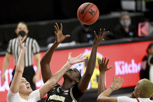 Maryland forward Mimi Collins (2), left, and Purdue center Fatou Diagne (45) battle for a rebound during the second half of an NCAA college basketball game, Sunday, Jan. 10, 2021, in College Park, Md. (AP Photo/Will Newton)