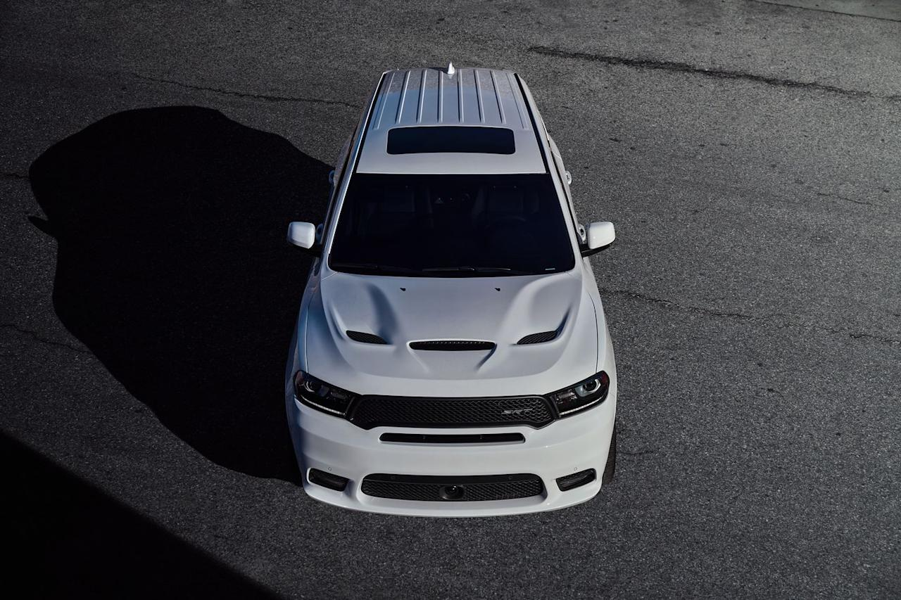"""<p>Fiat-Chrysler has yet to shoehorn its supercharged Hellcat engine into the Durango, one of the few vehicles it could actually fit in that hasn't received the 707-hp-plus option. (The Charger sedan, Challenger coupe, and Jeep Grand Cherokee with which the Durango shares its underpinnings all offer the blown V-8, but not the Durango.) That leaves the un-supercharged 6.4-liter Hemi V-8 as the Durango's top engine choice. Kicking out a prodigious 475 horsepower and 470 lb-ft of torque, the Hemi is strong enough to send <a rel=""""nofollow"""" href=""""https://www.caranddriver.com/dodge/durango-srt"""">the Durango SRT</a> model scurrying to 60 mph in just 4.7 seconds.</p>"""