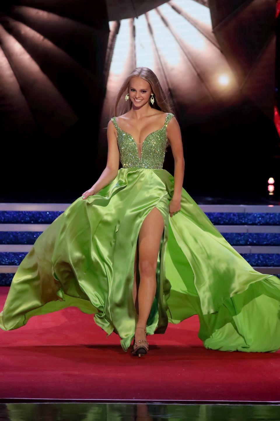 <p>Marisa Moorhouse of New Hampshire made sure she stole the show with this green gown. She sure knows how to work a train.</p>