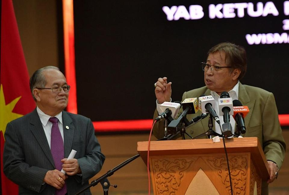 Sarawak Chief Minister Datuk Patinggi Abang Johari Openg (right) said the proposed Sarawak Petrochemical Hub is expected to create 74,000 new jobs, which could potentially contribute an additional RM16 billion to RM20 billion per annum to the state's GDP. — Bernama pic