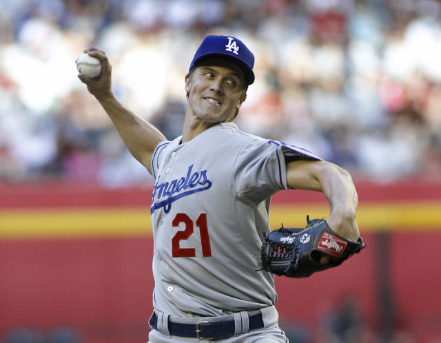 Los Angeles Dodgers' Zack Greinke delivers a pitch against the Arizona Diamondbacks during the first inning of a baseball game on Saturday, April 12, 2014, in Phoenix. (AP Photo/Ralph Freso)