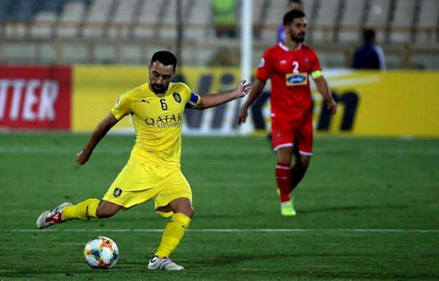 Xavi Hernandez's dazzling career came to an anti-climactic end when his side Al Sadd were beaten 2-0 by Iranian giants Persepolis in their last group match of the AFC Champions League on Monday (AFP Photo/ATTA KENARE)