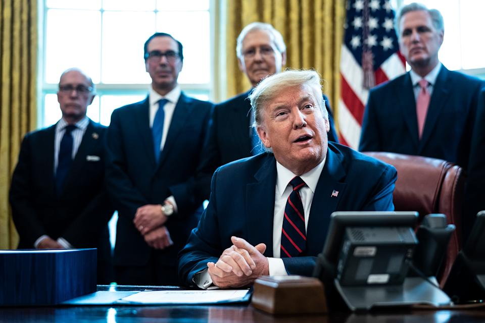 President Trump speaks during a bill signing ceremony for H.R. 748, the CARES Act in the Oval Office of the White House. (Photo by Erin Schaff-Pool/Getty Images)