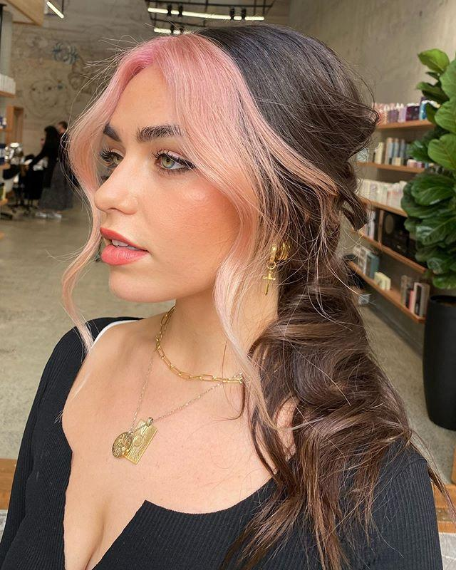 """<p>Two-tone hair was one of the biggest <a href=""""https://www.cosmopolitan.com/style-beauty/g9916693/best-summer-hair-colors/"""" rel=""""nofollow noopener"""" target=""""_blank"""" data-ylk=""""slk:hair color trends for summer 2020"""" class=""""link rapid-noclick-resp"""">hair color trends for summer 2020</a>, and if you've still got lighter pieces in the front, <strong>experiment with a fun color tint</strong> to change it up for this winter trend.</p><p><a href=""""https://www.instagram.com/p/CBUn1YUjgFq/?utm_source=ig_embed&utm_campaign=loading"""" rel=""""nofollow noopener"""" target=""""_blank"""" data-ylk=""""slk:See the original post on Instagram"""" class=""""link rapid-noclick-resp"""">See the original post on Instagram</a></p>"""