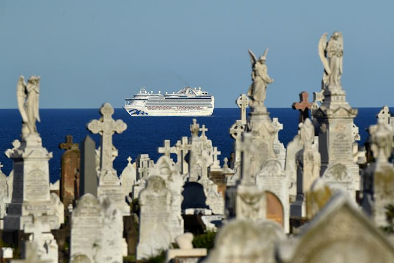 The cruise ship the ruby Princess sits of coast of Sydney, Sunday, April 5, 2020. A number of passengers from the Ruby Princess have died in due to the Coronavirus and a number of crew have been taken off and hospitalised.