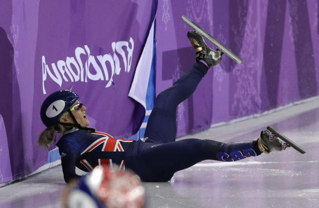 Elise Christie of Britain crashes during the ladies' 500 meters short track speedskating final in the Gangneung Ice Arena at the 2018 Winter Olympics in Gangneung, South Korea, Tuesday, Feb. 13, 2018. (AP Photo/David J. Phillip)