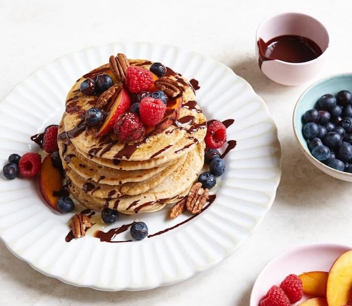 "<p>For those following a gluten-free diet, look to Madeleine Shaw's food <a rel=""nofollow"" href=""http://madeleineshaw.com/recipes/american-style-gluten-free-pancakes/"">blog</a> for inspo this Pancake Day. We'll be trying out her American-influenced stack. Complete with everything from mixed berries to hot chocolate sauce.<br /><br /><b>Ingredients:</b><br /><br /> 250g of gluten free flour<br /> 2 tbsp of coconut sugar<br /> 2 tsp if baking powder<br /> ¼tsp of sea salt<br /> ½ tsp of cinnamon<br /> 1 egg, beaten<br /> 200ml of almond milk<br /> 3 tbsp. of melted coconut oil<br /> 1 tsp of vanilla extract<br /> Butter or coconut oil for cooking<br /><em>To serve</em>: melted chocolate, maple syrup, toasted coconut flakes, frozen berries <em>[Photo: Madeleine Shaw] </em> </p>"