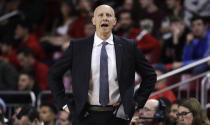 Louisville head coach Chris Mack calls to his players during the first half of an NCAA college basketball game against Boston College in Boston, Wednesday, Feb. 27, 2019. (AP Photo/Charles Krupa)