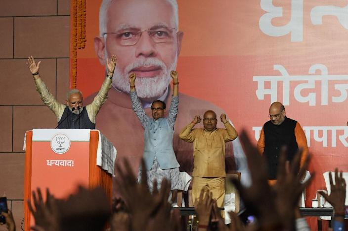 Indian Prime Minister Narendra Modi (L) during his victory speech at the Bharatiya Janata Party (BJP) headquarters after his re-election -- the first time in almost five decades that an Indian premier has been voted back with an increased majority (AFP Photo/PRAKASH SINGH)