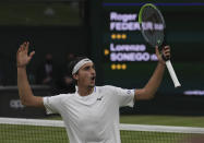 Italy's Lorenzo Sonego reacts during the men's singles fourth round match against Switzerland's Roger Federer on day seven of the Wimbledon Tennis Championships in London, Monday, July 5, 2021. (AP Photo/Alberto Pezzali)