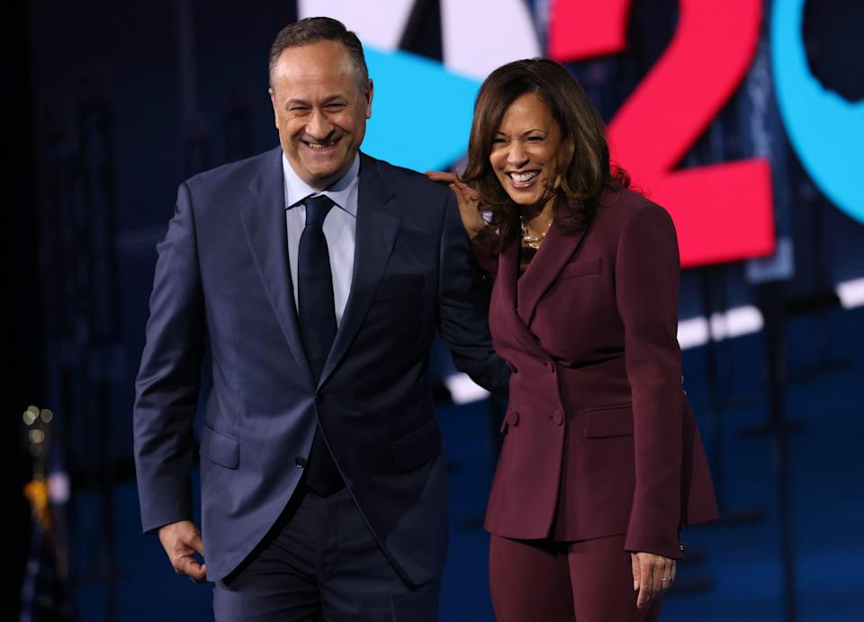 WILMINGTON, DELAWARE - AUGUST 19:  Democratic vice presidential nominee U.S. Sen. Kamala Harris (D-CA) and her husband Douglas Emhoff appear on stage after Harris delivered her acceptance speech on the third night of the Democratic National Convention from the Chase Center August 19, 2020 in Wilmington, Delaware. The convention, which was once expected to draw 50,000 people to Milwaukee, Wisconsin, is now taking place virtually due to the coronavirus pandemic. Harris is the first African-American, first Asian-American, and third female vice presidential candidate on a major party ticket. (Photo by Win McNamee/Getty Images)