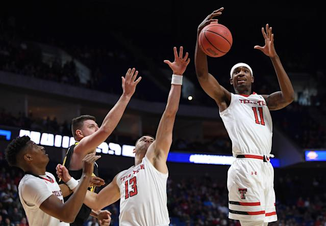 <p>Tariq Owens #11 of the Texas Tech Red Raiders gets the rebound near teammate Matt Mooney #13 during the first half of the first round game of the 2019 NCAA Men's Basketball Tournament against the Northern Kentucky Norse at BOK Center on March 22, 2019 in Tulsa, Oklahoma. (Photo by Harry How/Getty Images) </p>