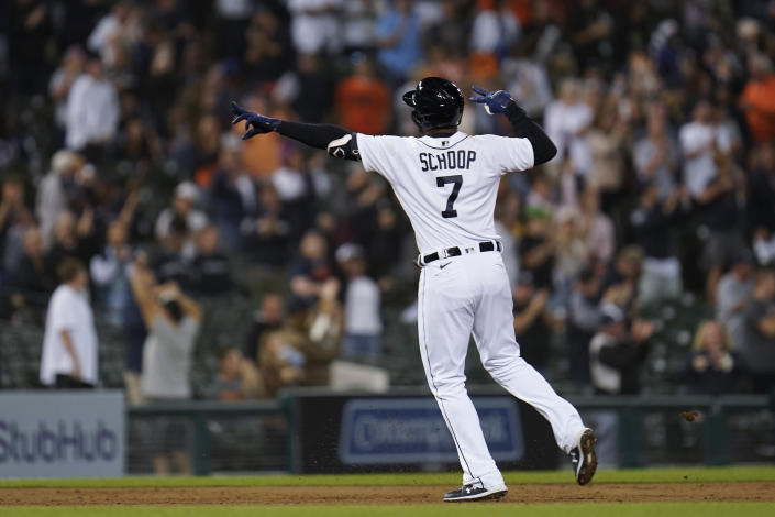 Detroit Tigers' Jonathan Schoop reacts to hitting a grand slam against the Tampa Bay Rays in the seventh inning of a baseball game in Detroit, Friday, Sept. 10, 2021. (AP Photo/Paul Sancya)