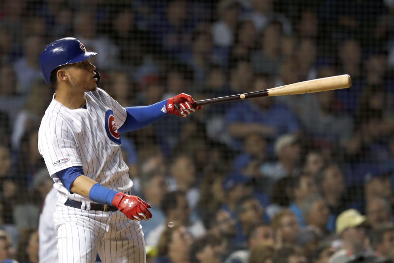 Chicago Cubs' Willson Contreras watches his home run off Cincinnati Reds relief pitcher Robert Stephenson during the seventh inning of a baseball game Wednesday, Sept. 18, 2019, in Chicago. (AP Photo/Charles Rex Arbogast)
