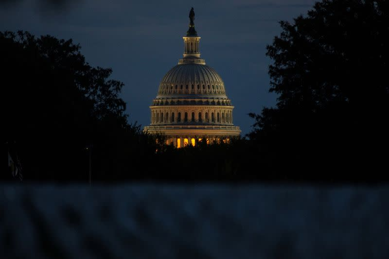 The U.S. Capitol building is pictured at dawn along the National Mall in Washington