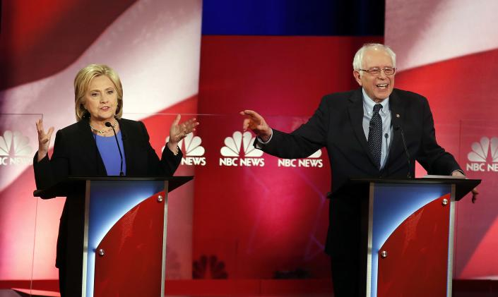 """<span class=""""s1"""">Hillary Clinton and Bernie Sanders interrupt each other during a Democratic presidential debate in January 2016. (Photo: Mic Smith/AP)</span>"""