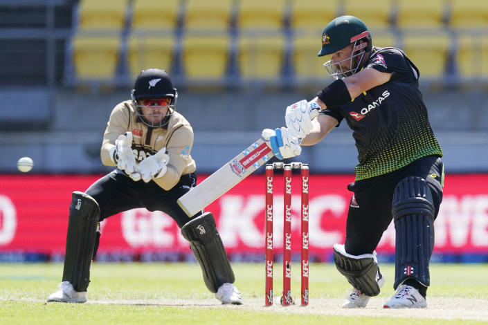 Australia's Aaron Finch, right, bats against New Zealand during their 5th T20 cricket international match at Wellington Regional Stadium in Wellington, New Zealand, Sunday, March 7 , 2021. (John Cowpland/Photosport via AP)
