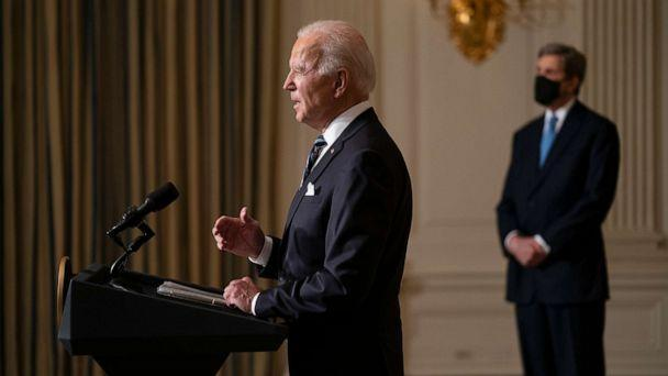 PHOTO: Special Presidential Envoy for Climate John Kerry, right, listens as President Joe Biden delivers remarks on climate change and green jobs, in the State Dining Room of the White House, Jan. 27, 2021. (Evan Vucci/AP, FILE)
