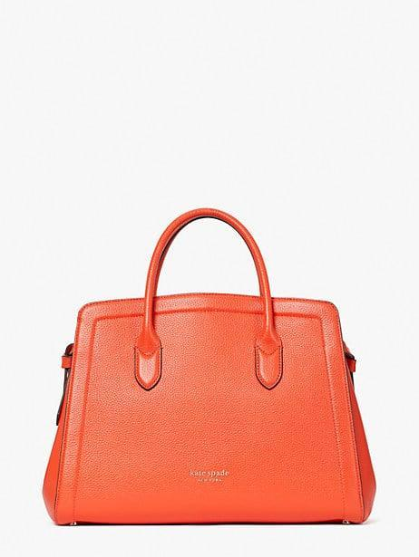 <p>For a pop of color, carry this <span>Kate Spade New York Knott Large Satchel</span> ($378) - it has tons of space inside.</p>
