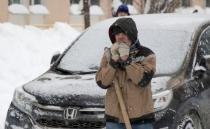 A worker removes snow in a street in Moscow