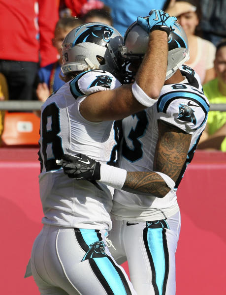 Carolina Panthers tight end Greg Olsen (88) is congratulated by teammate Louis Murphy (83) after his touchdown during the first half of an NFL football game against the Kansas City Chiefs at Arrowhead Stadium in Kansas City, Mo., Sunday, Dec. 2, 2012. (AP Photo/Colin E. Braley)