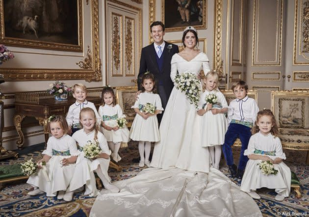 Mia Tindall, Savannah Phillips, Maud Windsor, Prince George, Princess Charlotte, Theodora Williams, Isla Phillips and Louis De Givenchy are pictured with Princess Eugenie and Jack Brooksbank in an official portrait.