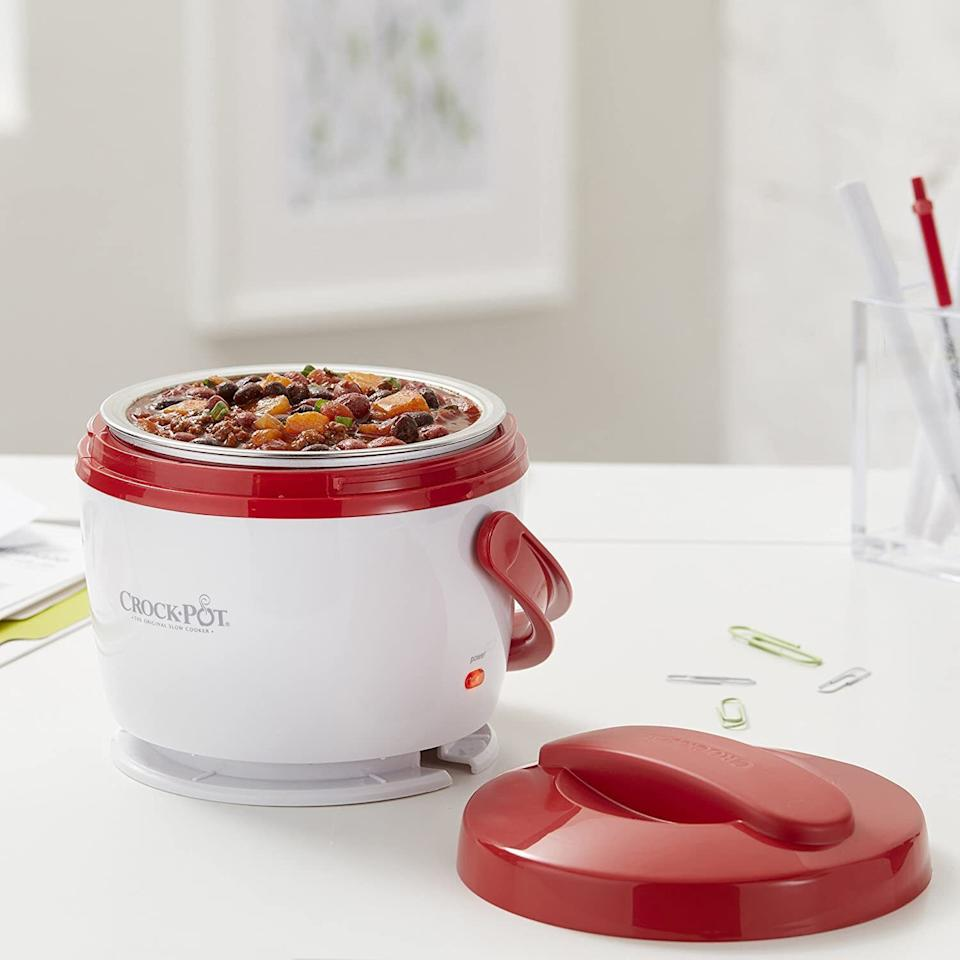 """So you canget all the warm deliciousness of a slow cooker on the go!This 20-ounce pot is perfect for personal use and it's dishwasher-safe.<br /><br /><strong>Promising Review:</strong>""""Everyone needs one of these! My hubs works nights so he is usually asleep through dinner time. I just put some in his little Crock-Pot and he has hot food for lunch. Must have for anyone looking to save money on food costs, or really anyone that eats at work during the day. The removable dish from inside makes cleaning it super easy."""" —<a href=""""https://www.amazon.com/gp/customer-reviews/R3A3W6MSSLT2LN?&linkCode=ll2&tag=huffpost-bfsyndication-20&linkId=7174b7ef8393a58b6cc31820c99df8a3&language=en_US&ref_=as_li_ss_tl"""" target=""""_blank"""" rel=""""noopener noreferrer"""">Robert Smith</a><br /><br /><strong>Get it from Amazon for <a href=""""https://www.amazon.com/Crock-Pot-Lunch-Crock-Food-Warmer/dp/B006H5V8US?&linkCode=ll1&tag=huffpost-bfsyndication-20&linkId=9eba24463bcd582b9a3689890fb03a8e&language=en_US&ref_=as_li_ss_tl"""" target=""""_blank"""" rel=""""noopener noreferrer"""">$21.99+</a> (available in seven colors).</strong>"""