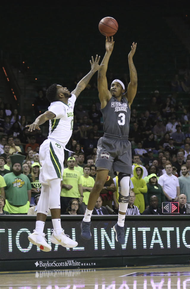 Mississippi State guard Xavian Stapleton, right, scores past Baylor guard Tyson Jolly, left, during the first half of an NCAA college basketball game in the second round of the NIT tournament, Sunday, March 18, 2018, in Waco, Texas. (Rod Aydelotte/Waco Tribune-Herald via AP)