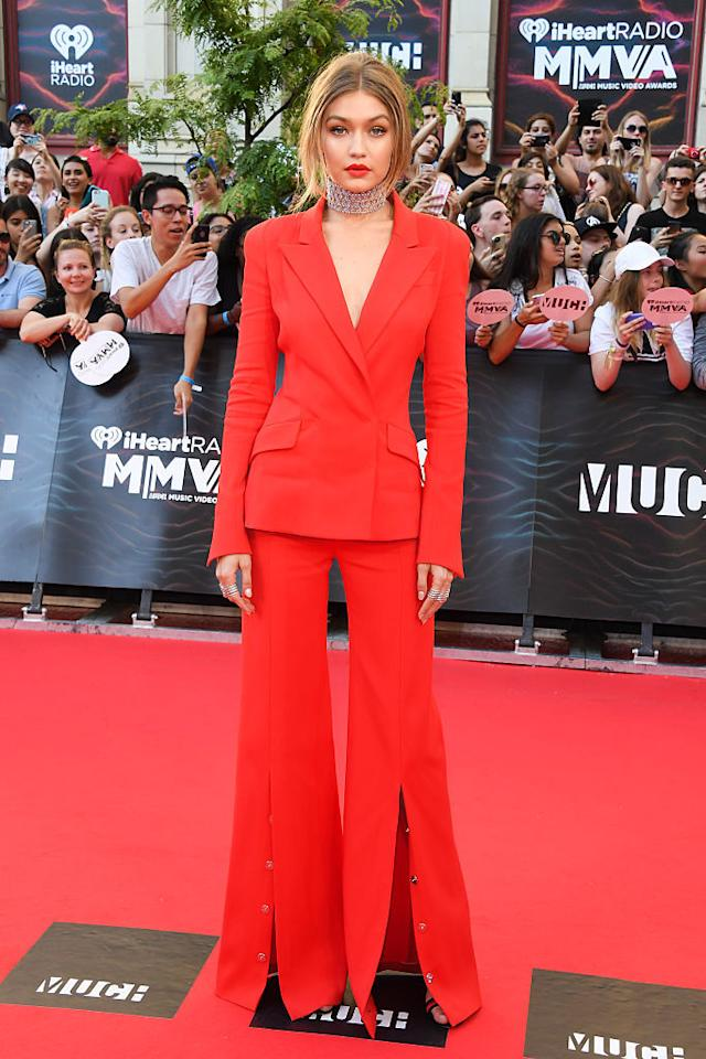 <p>The MMVAs host looked red hot in this fashion-forward Mugler suit with a deep V neckline.<i>(Photo by George Pimentel/WireImage)</i><br /></p>