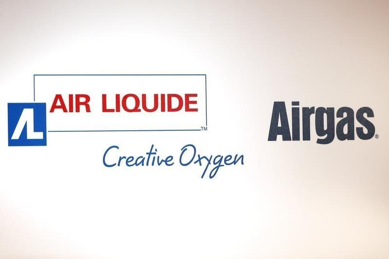 Air Liquide and Airgas logos are seen during a news conference in Paris