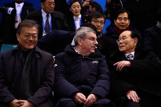 <p>North Korea's ceremonial head of state Kim Yong Nam (R) speaks with President of the International Olympic Committee Thomas Bach and South Korea's President Moon Jae-in (L) as they attend the the women's preliminary round ice hockey match between Switzerland and the Unified Korean team. </p>