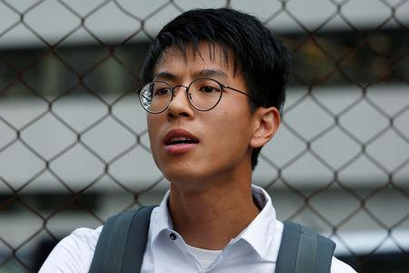 FILE PHOTO: A leader of localist group Hong Kong Indigenous Ray Wong leaves a court in Hong Kong