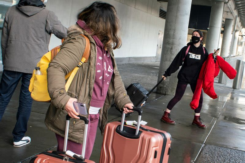 Passengers arrive on a flight from London amid new restrictions to prevent the spread of coronavirus disease (COVID-19) at JFK International Airport in New York City