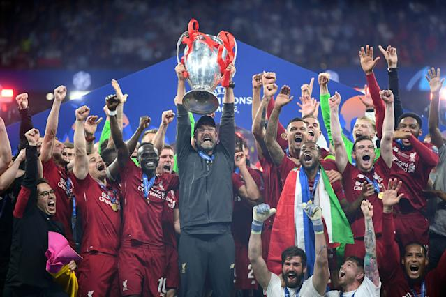 Jurgen Klopp lifts the Champions League trophy (Photo by Michael Regan/Getty Images)