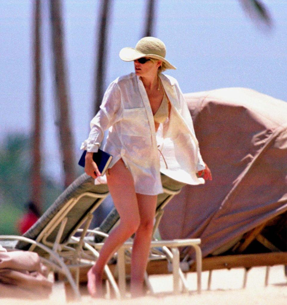 <p>Sharon Stone relaxing at the beach while on vacation in Hawaii. </p><p>Other celebrity visitors this year: Alec Baldwin, Ben Affleck, Courtney Love, Faith Hill, Josh Harnett.</p>