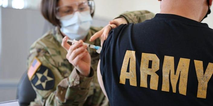 US Army nurse administers COVID-19 vaccine at Fort Meade in Maryland.