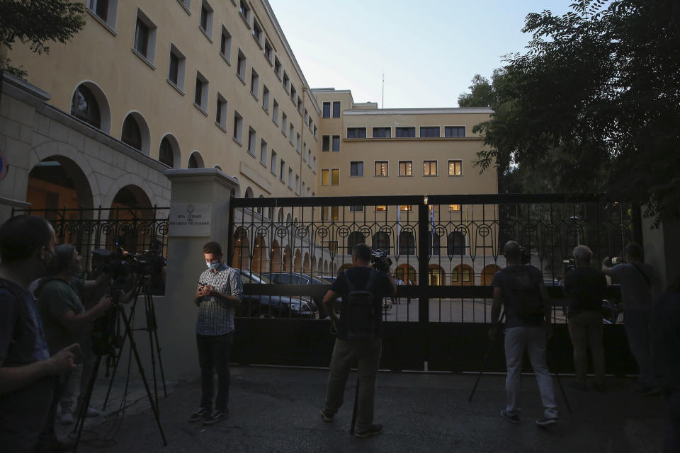 Journalists and cameramen stand outside Petraki Monastery in Athens, following an attack with a caustic liquid on Wednesday, June 23, 2021. Greek authorities say seven Greek Orthodox bishops have been hospitalized after allegedly being attacked with a caustic liquid by a priest facing a disciplinary hearing in Athens. The incident occurred at a meeting of senior church officials late Wednesday. (AP Photo/Petros Giannakouris)