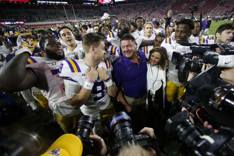 LSU head coach Ed Orgeron smiles at quarterback Joe Burrow after defeating Alabama in an NCAA football game Sunday, Nov. 10, 2019, in Tuscaloosa , Ala. LSU won 46-41. (AP Photo/John Bazemore)