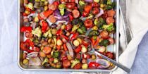 """<p>This colorful, easy way to serve delicious veggies and sausage bites is a great way to feed a crowd. Plus, it just looks pretty.<a href=""""https://www.delish.com/cooking/recipe-ideas/a36146173/sheet-pan-sausage-and-vegetables-recipe/"""" rel=""""nofollow noopener"""" target=""""_blank"""" data-ylk=""""slk:"""" class=""""link rapid-noclick-resp""""><br></a></p><p><em><strong><em><strong>Get the recipe at</strong></em> </strong></em><em><strong><a href=""""https://www.delish.com/cooking/recipe-ideas/a36146173/sheet-pan-sausage-and-vegetables-recipe/"""" rel=""""nofollow noopener"""" target=""""_blank"""" data-ylk=""""slk:Delish"""" class=""""link rapid-noclick-resp"""">Delish</a>. </strong></em></p>"""