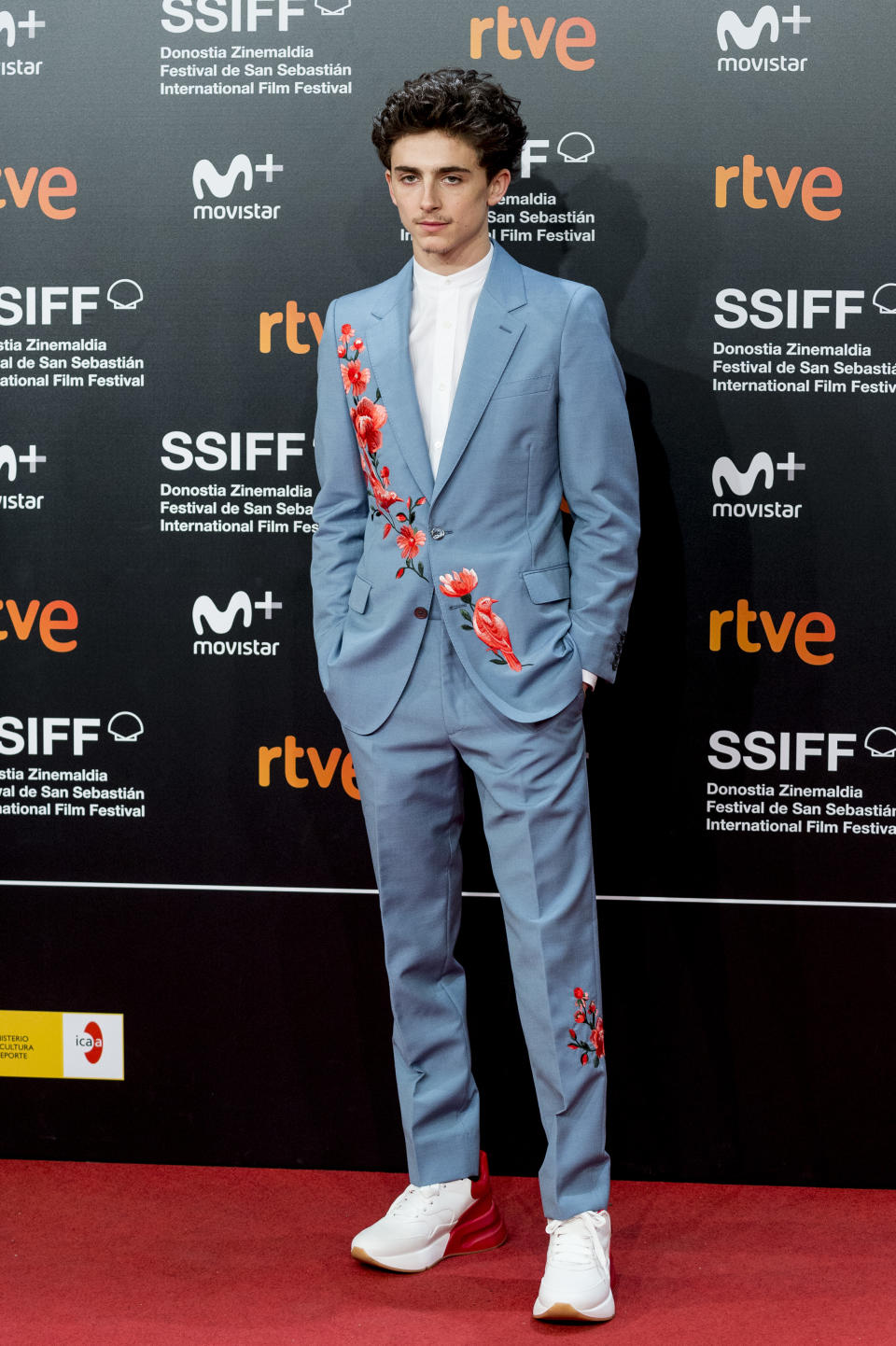 Wearing a blue suit with floral detailing. <em>[Photo: Getty]</em>