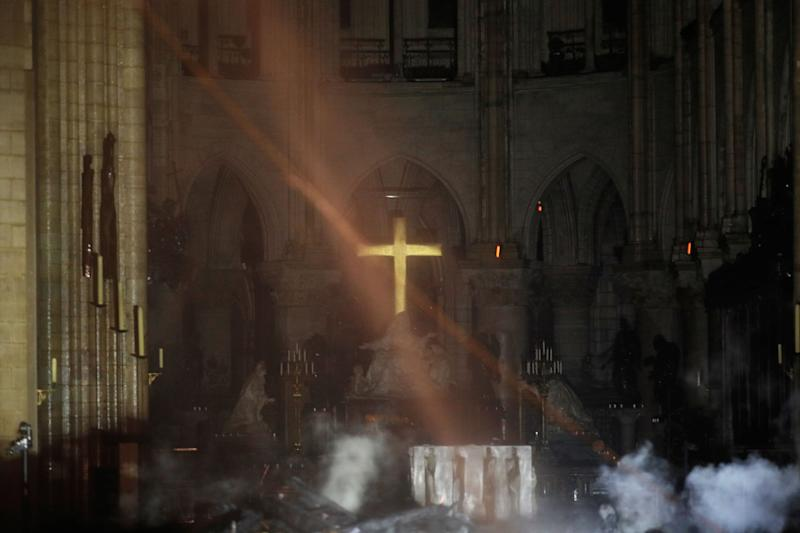 Smoke rises around the altar in front of the cross inside the Notre Dame Cathedral as a fire continues to burn in Paris, France, April 16, 2019. (Photo: Philippe Wojazer/Pool/Reuters)